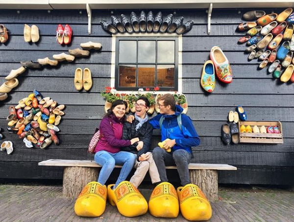 Javier and his assistants sat on a bench outside of a traditional clog shop