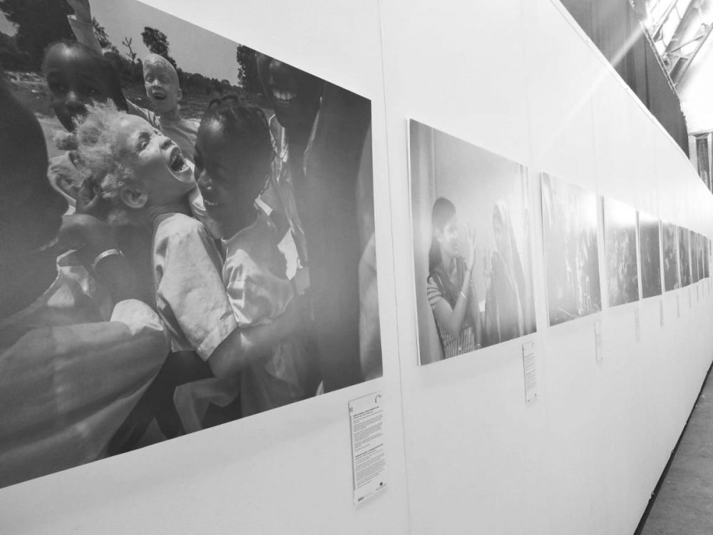 Photo exhibition of children on the wall