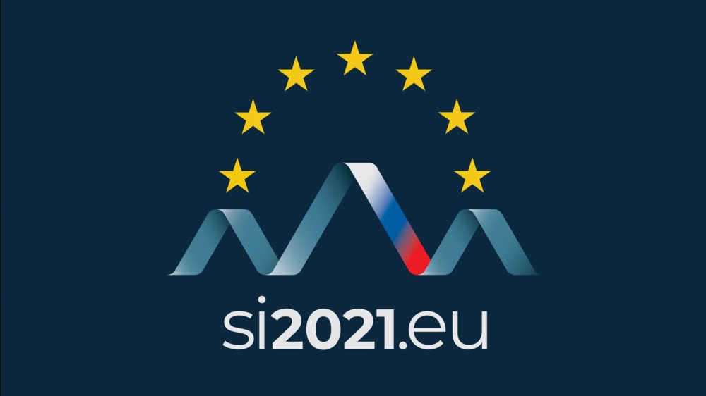 Logo of the Slovenian Presidency - the stars o the EU flag with a the slovenian flag in the shape of mountains